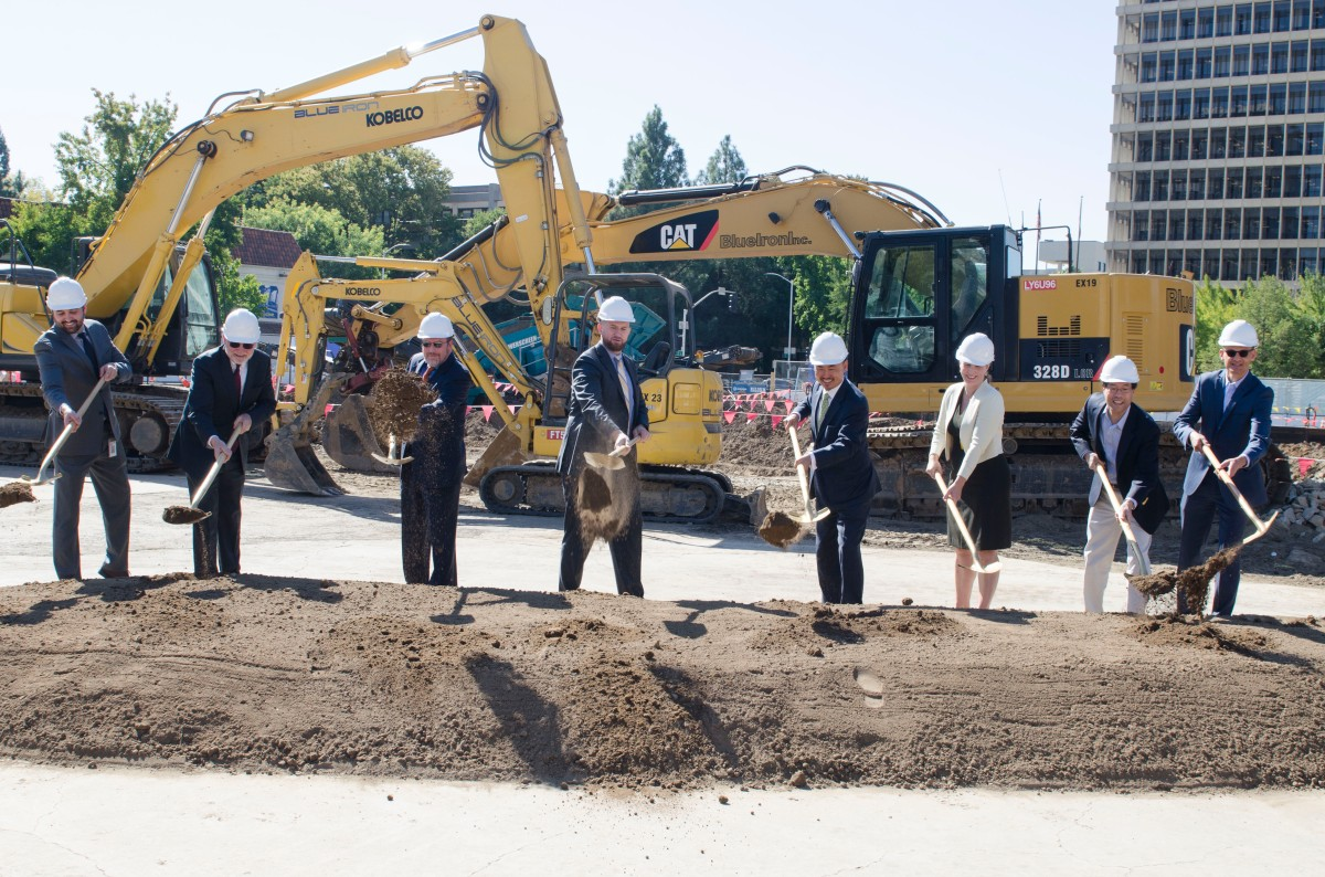 Officials Move Dirt at Groundbreaking Ceremony!
